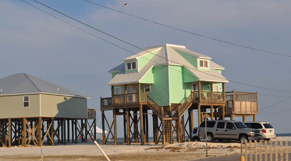 19   Example Of A Stilt House On Sand Next To The Ocean